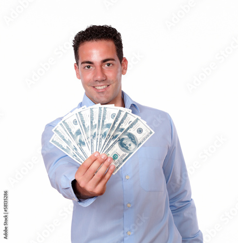 Friendly man standing and holding dollars