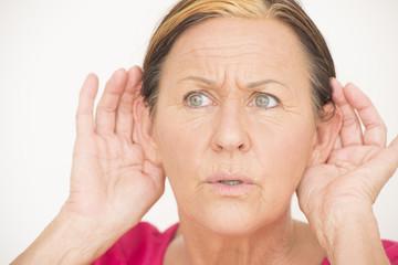Worried shocked woman listening