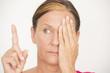 Woman Eyesight focus test on finger