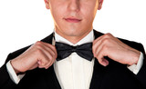 man in a black suit adjusts his bow tie close-up face