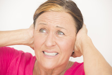 Stressed woman with hands on head