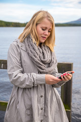 young woman reading on her smartphone