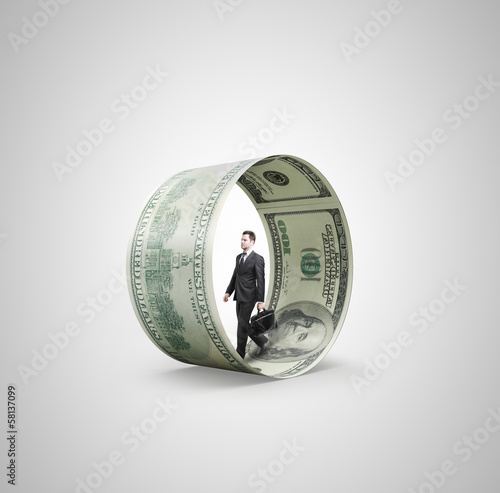 man walking in money wheel