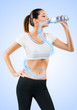 Fit young woman drinking water