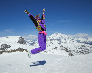 Happy woman jumping in the mountains