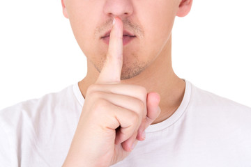 close up of man with finger on lips asking for silence over whit
