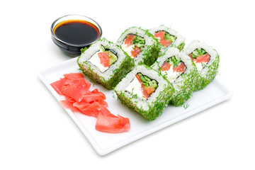 Appetizing tasty Japan rolls on a plate on a white background.