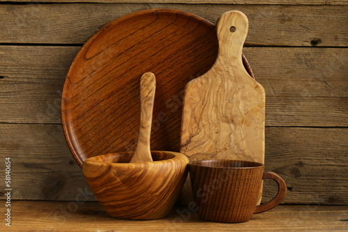 set of wooden organic utensils on natural wooden background