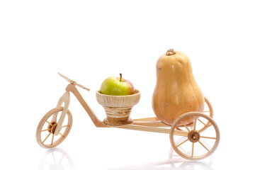 fresh apple and pumpkin in a bike