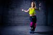 Woman dancing in urban environment