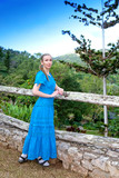 Cuba.beautiful woman in a blue dress in park of Soroa