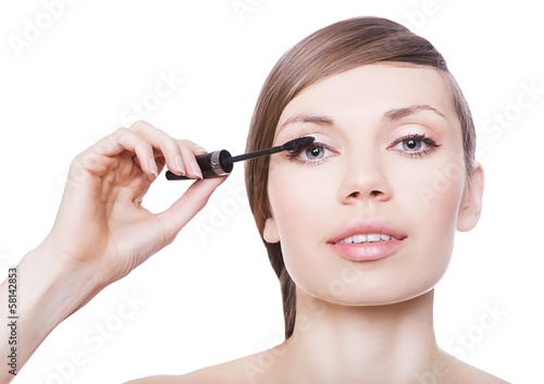 attractive woman with mascara brush
