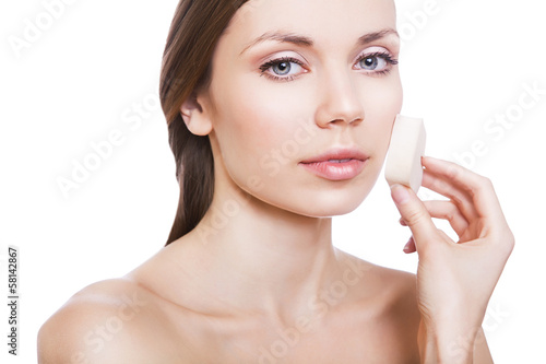 beautiful woman with powder sponge