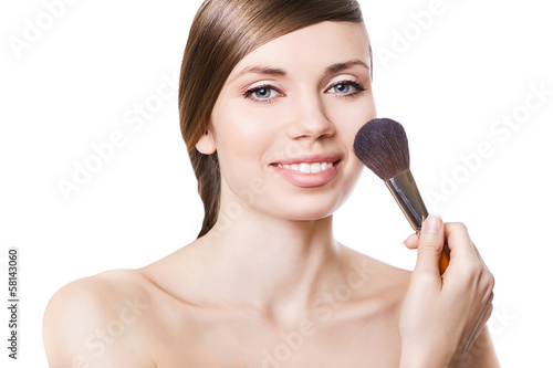 natural smiling woman and brush on cheek