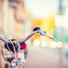 Vintage Bike Handlebar with a Background Made of Traffic Jam