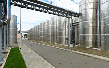 Modern aluminum barrels where grape juice is aged into wine