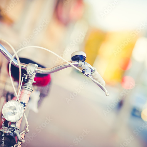 Detail of a Vintage Bike Handlebar with a Colorful Background