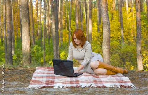 Beautiful young girl with the laptop