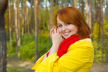 Portrait of red-haired girl outdoors