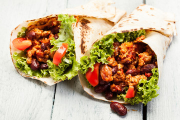 Burrito. Tortilla with meat and beans