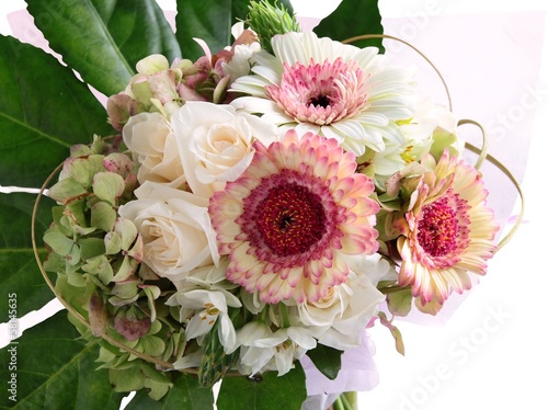 gerber and roses in ornamental posy for gift