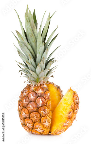 pineapple with a slice isolated on white background