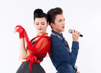 Girl in a vintage suit and stylish man with microphone