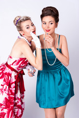 Two beautiful girls in a vintage dress telling tales