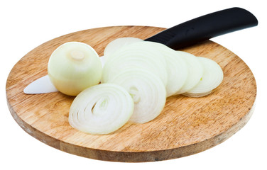 bulb and sliced onions with ceramic knife on board