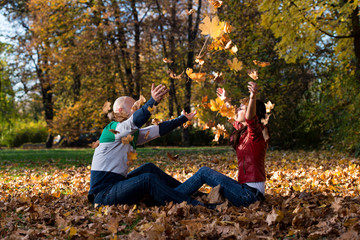 Couple Playing In The Leaves
