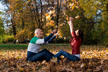 Couple Playing Together In The Woods Outside During Autumn