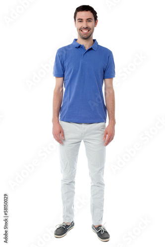 Cool young smiling guy in casual attire