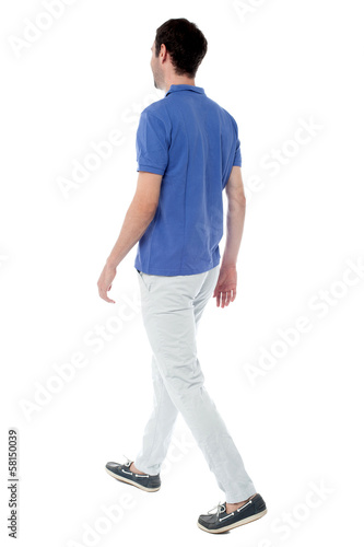Casual guy walking away from the camera