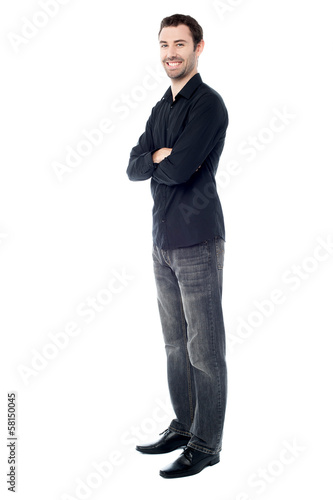 Young casual guy, full length shot.