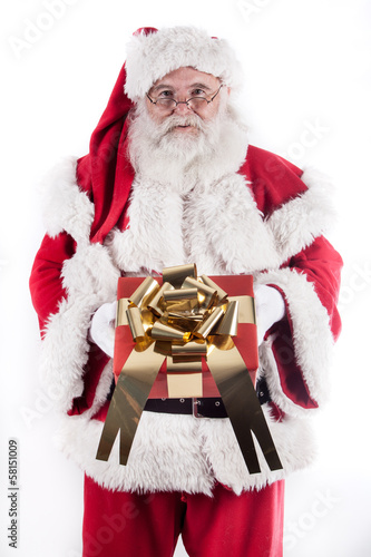 Santa Claus holds in his hands a gift