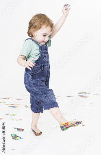 young child with paint on feet