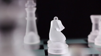 Crystal chess. 2 scenes - Knight and bishop take the queen.