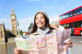 London tourist woman sightseeing holding map