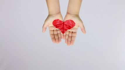 showing a painted heart with hands