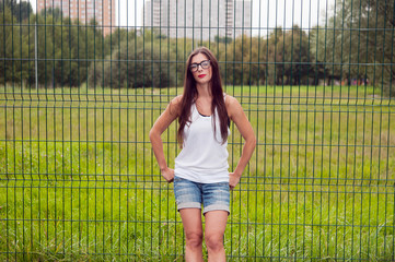 Portrait Of Young Woman Wearing Glasses On Playground