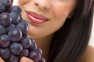beautiful woman and fresh grapes