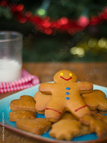 Delicious gingerbread man and shapes with a glass of milk
