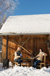 Two girlfriends enjoy tea snow winter cottage