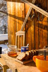 Snow winter cottage breakfast on wooden table