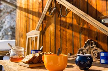 Breakfast wooden table outside winter snow cottage
