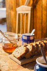 Tea and fruit bread outside winter cottage
