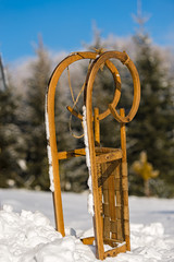Snow sledge standing in winter countryside