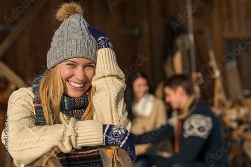 Young smiling woman in winter clothes cottage