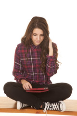 Woman sit cross legged tablet look down