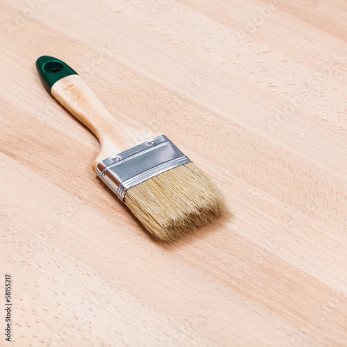 paint brush on beech wooden board